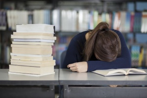 Female college student tired from studying
